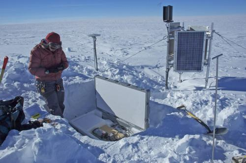Leigh checking on GPS instrumentation at Byrd Glacier, East Antarctica.